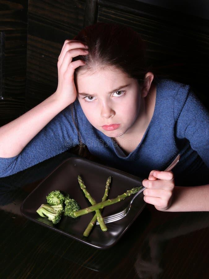 barn som vägrar grönsaker royaltyfri bild