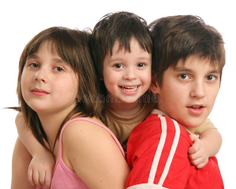 barn tre arkivfoton