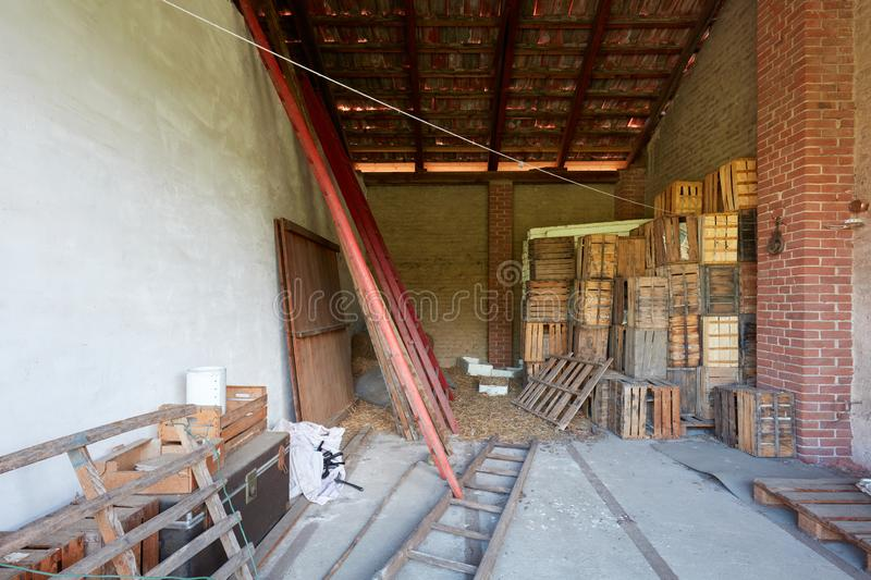 Barn under the roof used as deposit in an old country house. In Italy stock photography