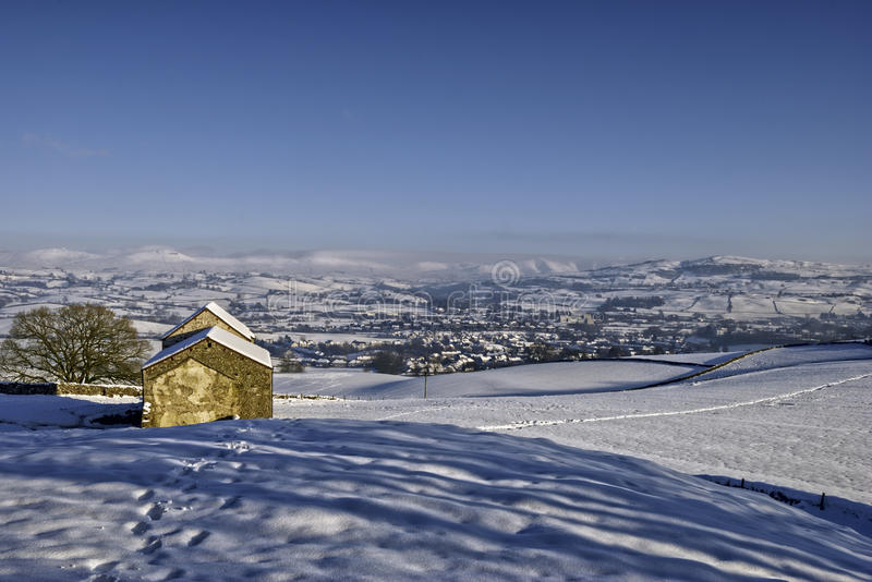 Barn in Wintry landscape royalty free stock image