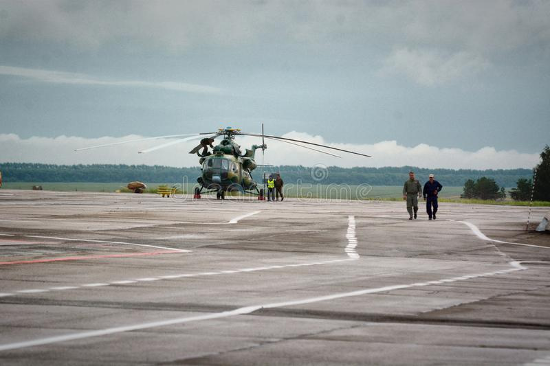 Barnaul,Russia-17 Jul 2018.The pilot and the aircraft are on the background of military transport helicopter stock photography
