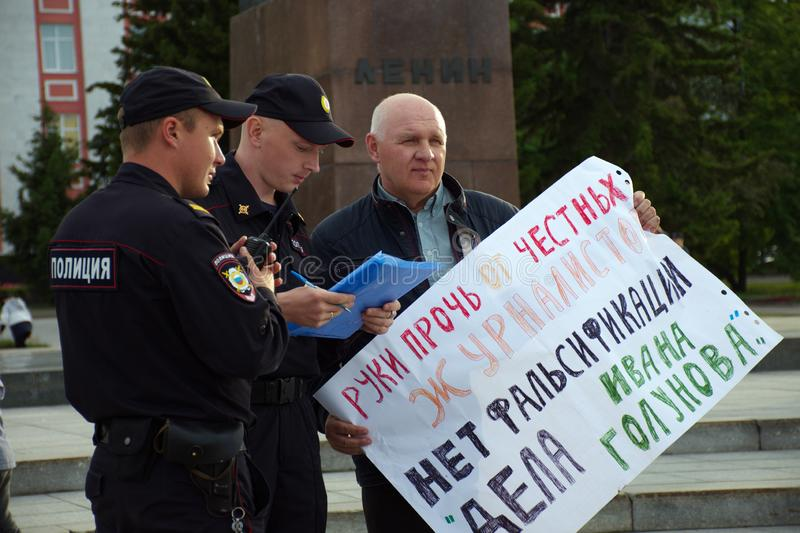 A man with a poster in support of correspondent Ivan Golunov and honest journalists detained by polic. Barnaul,Russia-July 9, 2019. A man with a poster in royalty free stock images