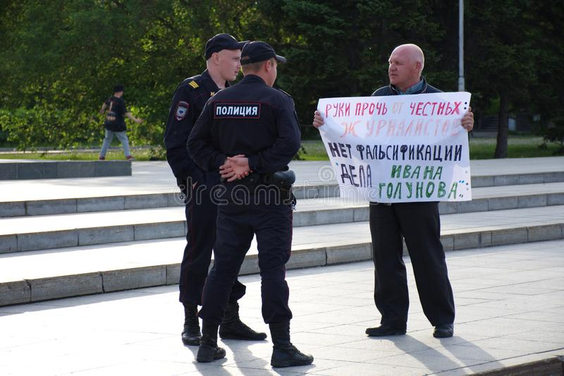 A man with a poster in support of correspondent Ivan Golunov and honest journalists detained by polic. Barnaul,Russia-July 9, 2019. A man with a poster in stock photography