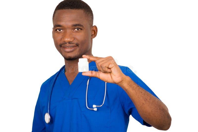 Barndoktor som rymmer en medicinask royaltyfria foton