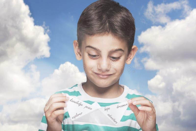Barndom-, dagdrömma och hoppbegrepp royaltyfri foto