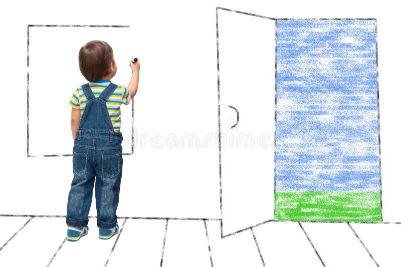 Barnet drar ett imaginärt fönster arkivfoton