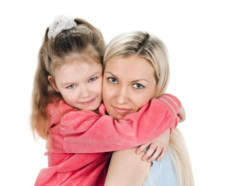 Barnet fostrar den lilla dottern royaltyfri bild