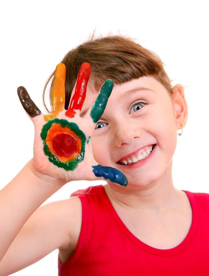 Barnet med målat gömma i handflatan fotografering för bildbyråer