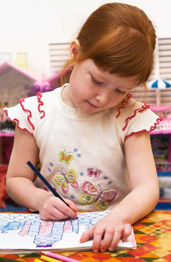 barnet tecknar dagiset royaltyfri bild