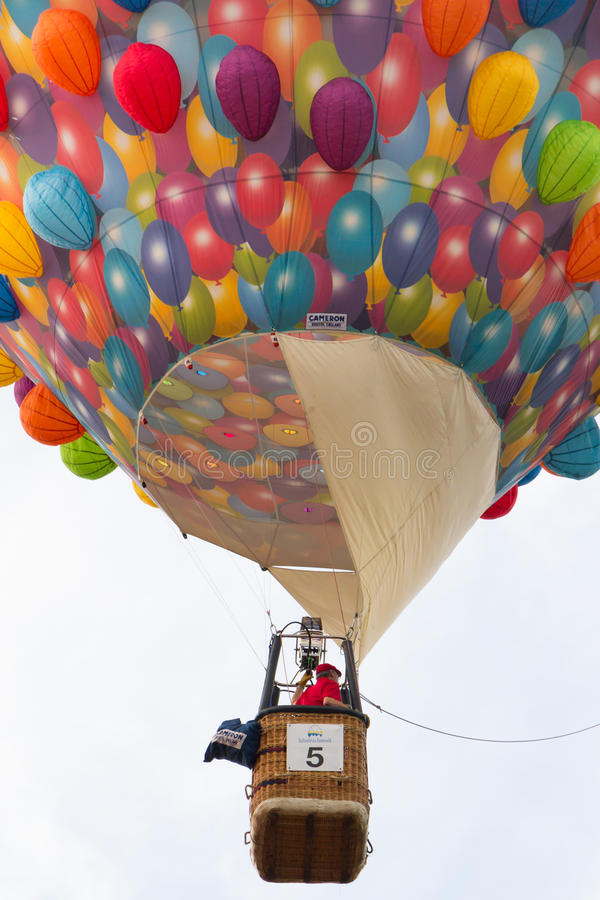 BARNEVELD, THE NETHERLANDS - AUGUST 28: Colorful air balloons ta. A colourful balloon ready for take off at the balloonfiesta in Barneveld in the Neherlands. An royalty free stock photography
