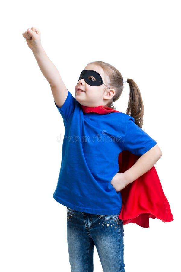 Barnflickan spelar superheroen royaltyfria foton