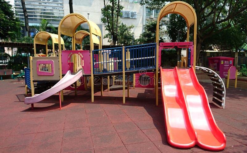 Barnlekplatsleksak arkivbild