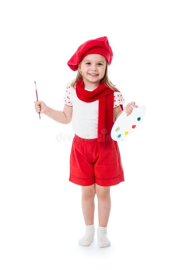 Barnliten flicka i konstnärdräkt med målarpenseln och paletten royaltyfri fotografi