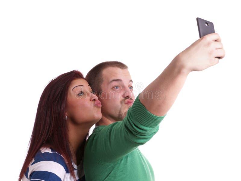 Barnpar som tar selfie royaltyfria foton