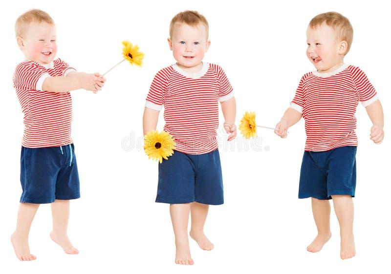 Barnpojke med blomman, lycklig unge som isoleras över vit royaltyfri fotografi