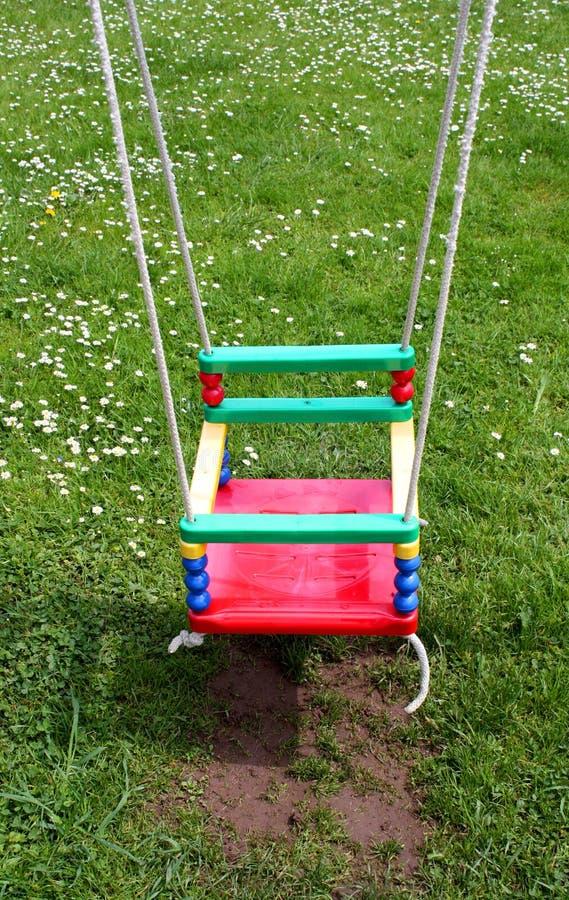 barns färgrika swing royaltyfria foton