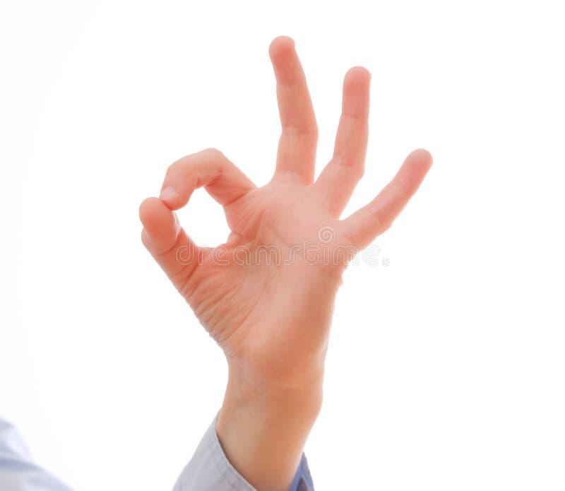 Barns hand som visar en reko positiv gest arkivfoto