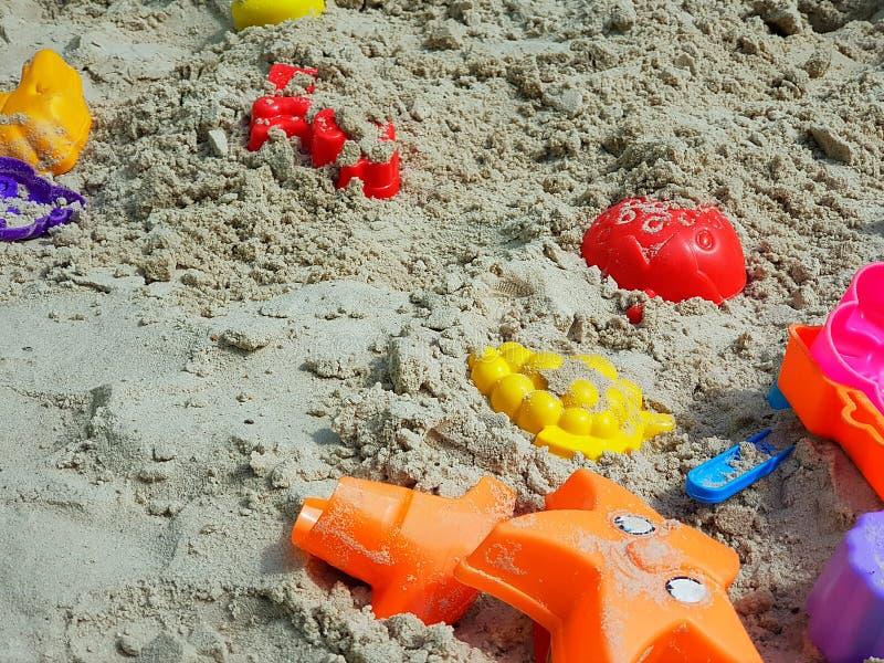 Barns leksaker i sanden royaltyfria foton