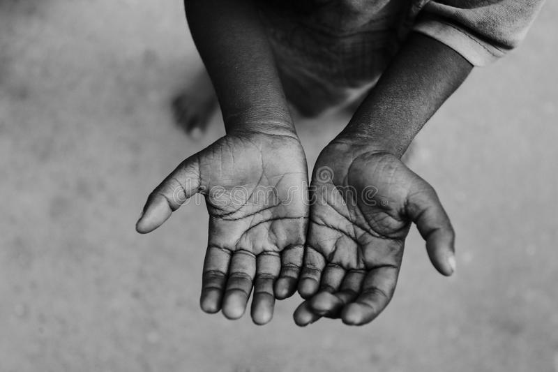 Barntiggarehand fotografering för bildbyråer