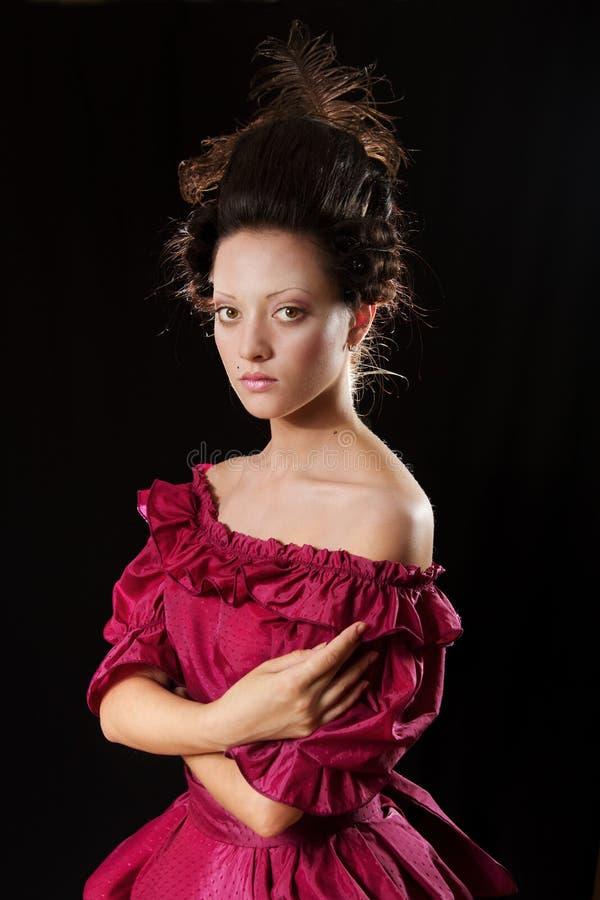 Barokke vrouw in historisch kostuum met hoepelrok royalty-vrije stock afbeeldingen