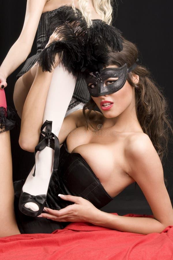 Barokke vrouwen met een masker stock foto's