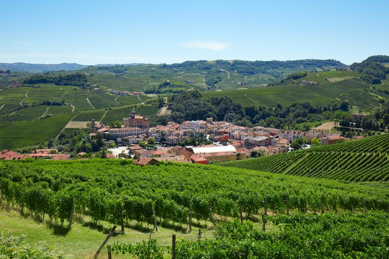 Barolo medieval town on Langhe hills in Italy, vineyards view. In a sunny day royalty free stock images