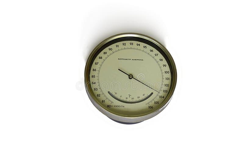 Barometer en apparat för att mäta atmosfärstryck, på en vit bakgrund arkivbild