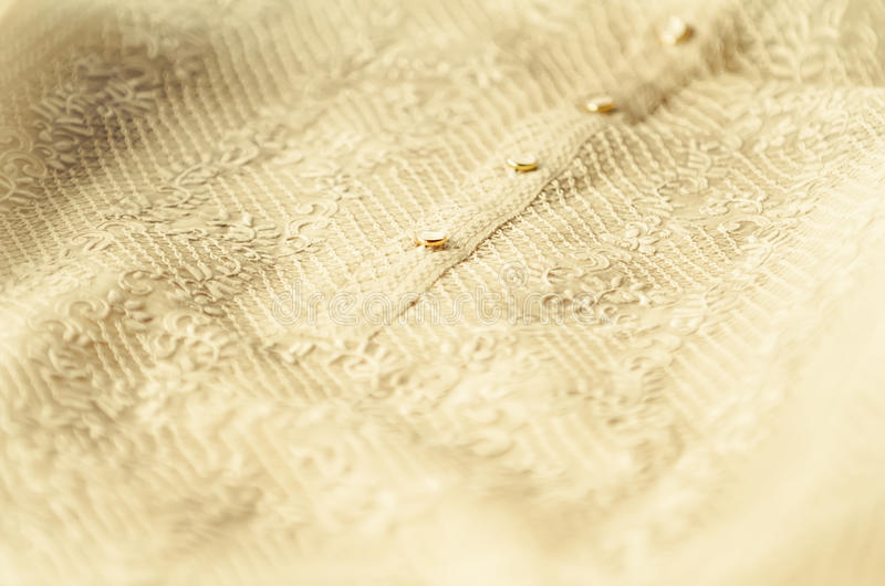 Barong Tagalog. Closeup of groom's Barong Tagalog during a Philippine wedding stock photography