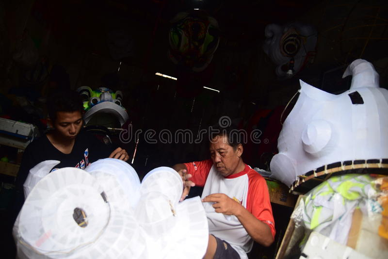 Barongsay maker. Sutikno lion dance makers in Semarang, Central Java, January 18, 2015, flooded with orders ahead of the Chinese New Year celebration or Imlek royalty free stock photo