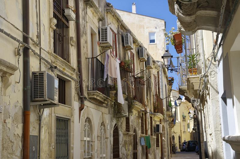 Baroque balconies in narrow alley in Syracuse on Ortigia island, Sicily, Italy. The baroque balconies in narrow alley in Syracuse on Ortigia island, Sicily stock photography