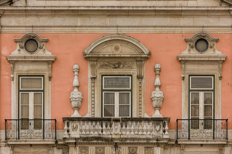 Baroque balcony and windows. Foz palace. Lisbon. Portugal. Detail of the facade. Balcony and windows. Foz palace, built in the 18 century , today it houses the stock images