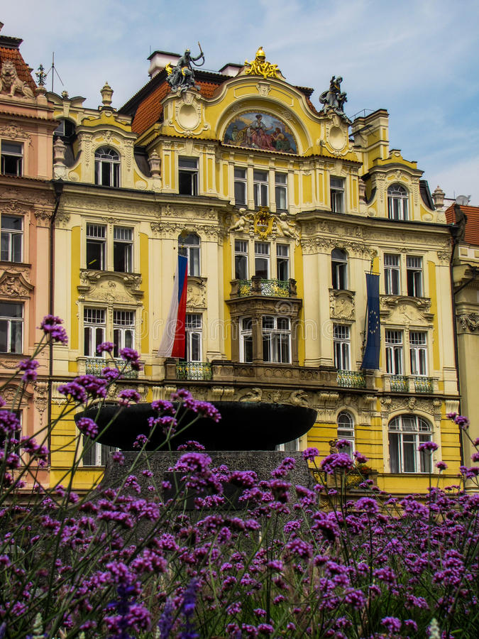 Baroque buildings in Prague Old Town Square. Summer view of Baroque buildings in Prague Old Town Square with flowers in the foreground and both the Czech and royalty free stock photos