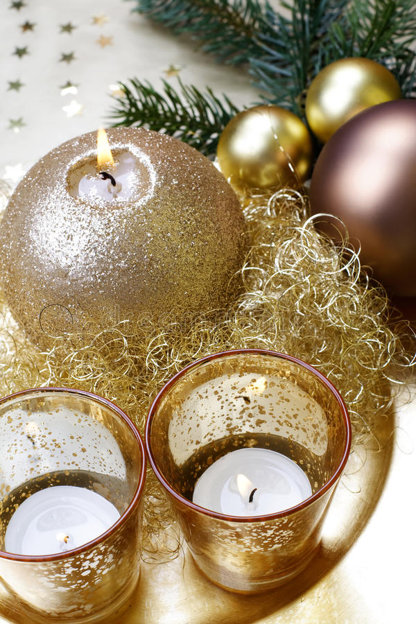 Baroque Christmas candle, still life. Burning golden, baroque Christmas candle, still life royalty free stock images