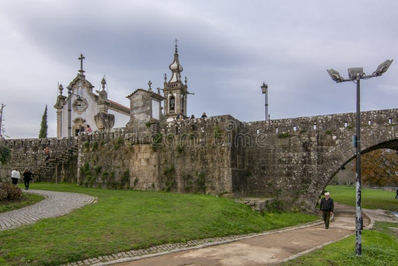 Baroque church of Santo Antonio and Roman Bridge of the village of Ponte de Lima royalty free stock photography