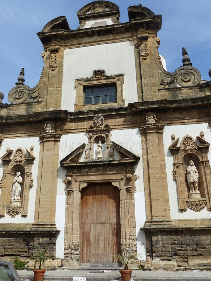 Baroque facade of the parish of Santo Stefano Protomartire near the Zisa in Palermo in Sicily, Italy. Travel destination. Blue clear sky with sun. Statues royalty free stock images