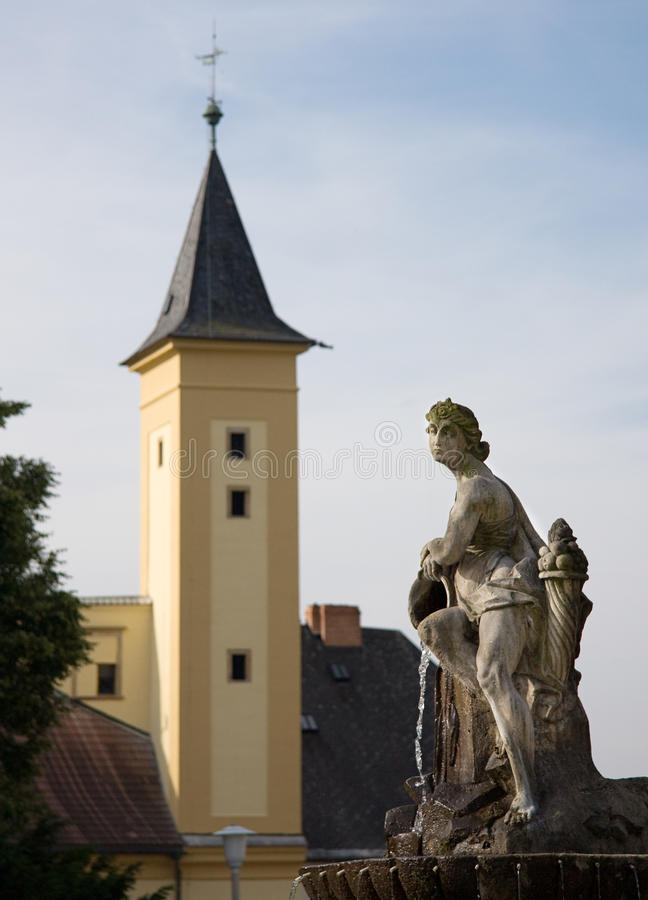 Baroque fountain - Zabreh. Baroque fountain in town Zabreh, Czech Repulic. On against background is Chateau Zabreh, the oldest lendmark of town Zabreh. Fountain royalty free stock photos