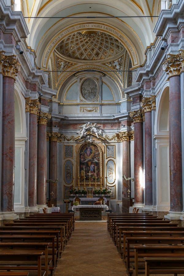 Baroque interior of the church in Anguillara Sabazia town, Italy. ANGUILLARA SABAZIA / ITALY - JULY 2015: Baroque interior of the church in Anguillara Sabazia stock images