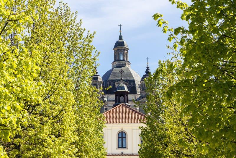 Baroque monastery through green trees royalty free stock photos