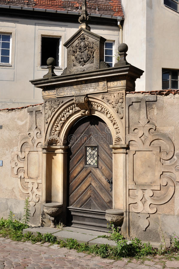 Baroque portal, meissen. Detail of baroque portal in stone with decorated frieze in ancient city centre royalty free stock photography
