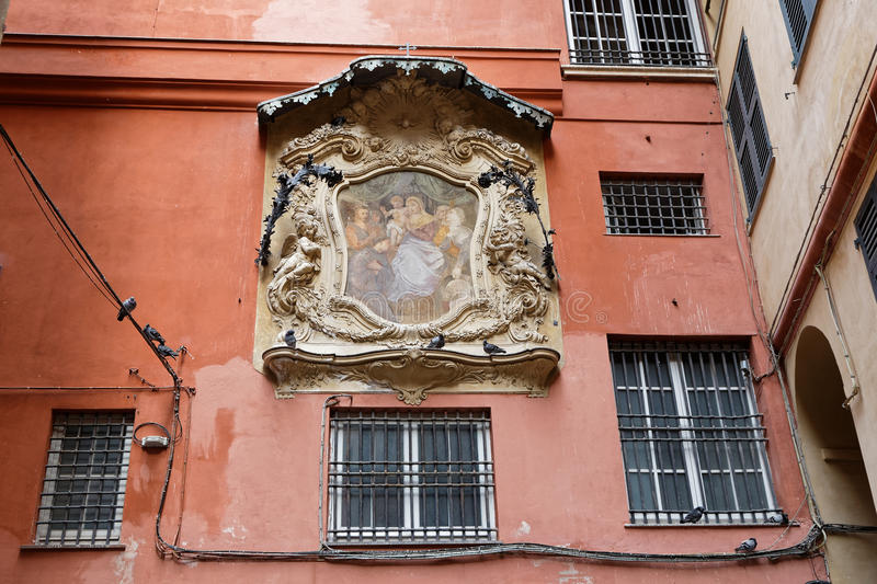 A baroque small street in Genoa city center. Genoa is the capital of the Italian region of Liguria and the sixth-largest city in Italy stock images