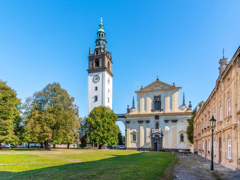 Baroque St. Stephen`s Cathedral with bell tower at the Cathedral Square in Litomerice, Czech Republic stock photography