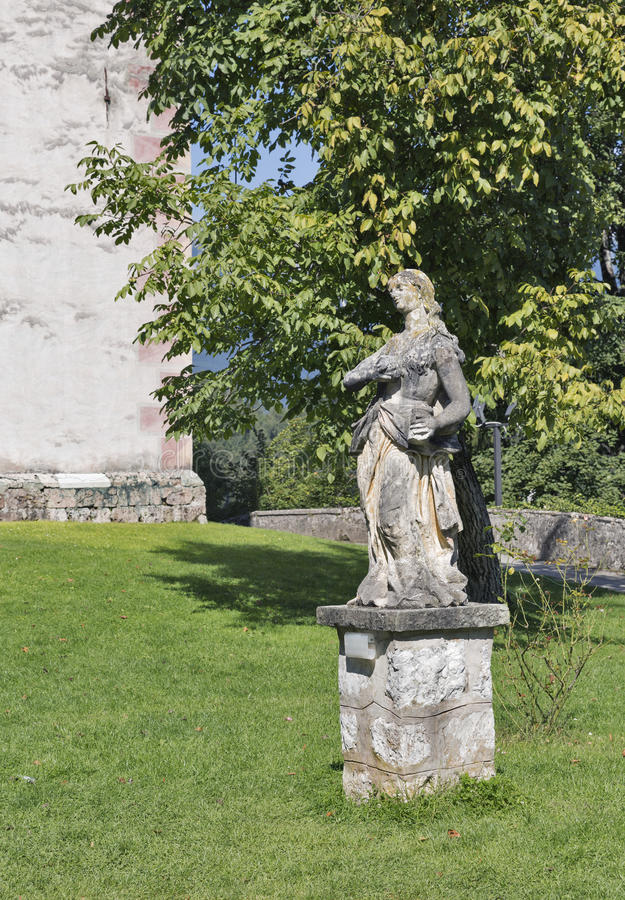 Baroque statue of Mary Magdalene in Bled, Slovenia. Baroque statue of Mary Magdalene in courtyard of Church of the Assumption of Mary on lake Bled island in royalty free stock photos