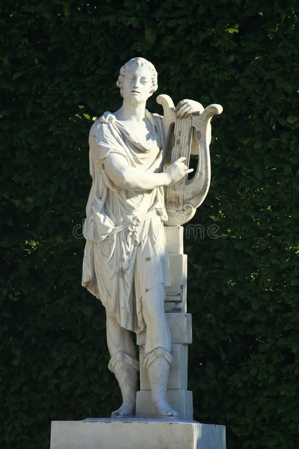 Free Baroque Statue Of A Man Holding A Cithara Stock Images - 31749144