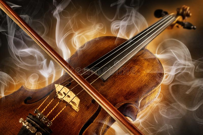 Baroque violin. Violin surrounded from light and smoke stock image