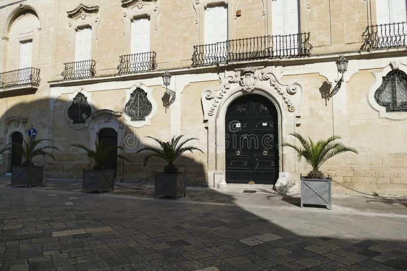 Baroque wrought iron windows and doors. On limestone palaces of Lecce, Puglia, Italy royalty free stock photos