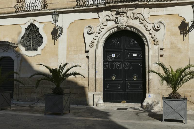 Baroque wrought iron windows and doors. On limestone palaces of Lecce, Puglia, Italy royalty free stock images