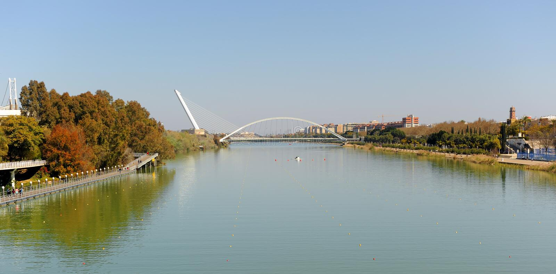 The Barqueta bridge at the River Guadalquivir, Seville, Spain. Panoramic view of the famous river Guadalquivir that crosses the city of Seville with the bridges stock photos
