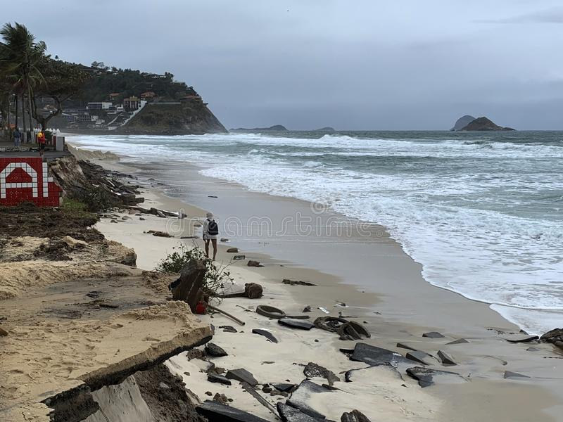 Barra da Tijuca beach after the giant waves. That destroyed the boardwalk stock photos