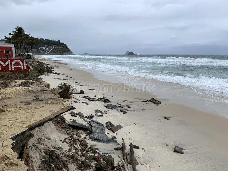 Barra da Tijuca beach after the giant waves. That destroyed the boardwalk royalty free stock image