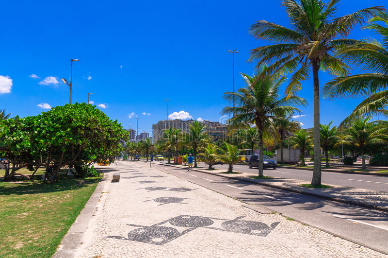 Barra da Tijuca beach with mosaic of sidewalk in Rio de Janeiro royalty free stock image